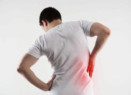 Болит спина на уровне талии
